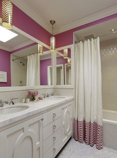 Patterned Fabric Border added to white shower curtain in pink bathroom with marble countertops, white vanity, hanging silver sconces, dual sinks and mosaic tile - by Tineke Triggs of Artistic Designs for Living