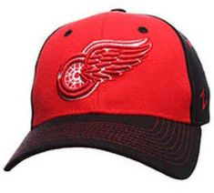 Detroit Red Wings Caps are made by Zephyr. They are red and black  in color with red colored dot on top and air holes. The front of the Detroit Red Wings Hat is embroidered with the Red Wings Logo. The Zephyr logo is monogrammed on the side. The back of the hat has a Monogram of D. The hat is the structured variety and is a flexfit – stretch style.