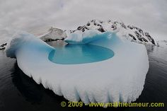 Iceberg swimming pool  Iceberg swimming pool in Pleneau Bay, Antarctica .   Top Pinterest pick by RetoxMagazine.com