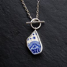Pottery Shard jewelry - Blue and White Painted Shard Pendant in Silver with Stars. via Etsy. love it! #ecrafty