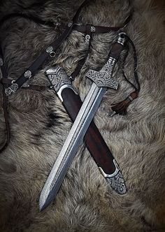 """Mjolnir"" in Swords by Danok. Swords And Daggers, Knives And Swords, Espada Viking, Viking Sword, Viking Shield, Viking Life, Medieval Weapons, Best Pocket Knife, Arm Armor"