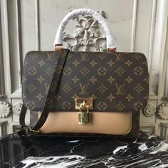 Marignan The Messenger In Monogram Canvas And Grained Leather Is Quintessence Of Everything That Makes Louis Vuitton Bags Very Definition