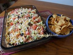 LAYERED TACO DIP-Very versatile dip, tastes great and wont last long. Wonderful for large groups and entertaining.