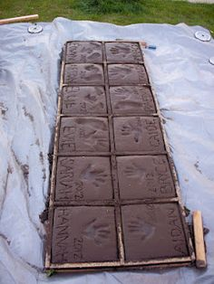 Home made paving stones. Take those imprints with you when you move! A great alternative to doing them in a patio or driveway.