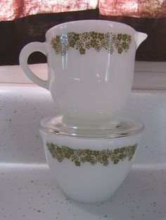 Spring Blossom Creamer and Sugar Bowl- from a teensy resale shop, 4 bucks for the set!  My sugar bowl is without a lid, so I'm still on the lookout!