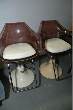 Pair of mid century Takara Belmont Lucite barber chairs. Tagged on seat cushion Takara. Each measures Endeavor charity item. Barber Chair, Mid Century Style, Seat Cushions, Charity, Auction, Retro, Home Decor, Bench Seat Cushions, Decoration Home