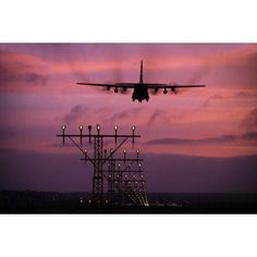 A C-130J Super Hercules landing at Ramstein Air Base Germany Canvas Art - Timm ZiegenthalerStocktrek Images (35 x 23)