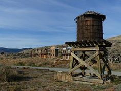 AN OLD WATER  TOWER AT AN OLD GHOST TOWN IN TEXAS ONCE A THRIVING TOWN NOW JUST A MEMORY
