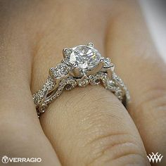 This 3 Stone Engagement Ring is from the Verragio Insignia Collection. It features 0.50ctw (F/G VS) round brilliant cut diamond melee to enhance a round diamond center of your choice. The width tapers from 2.7mm at the top down to 2.2mm at the bottom. Select your diamond from our extensive online diamond inventory. Please allow 4 weeks for completion. Platinum rings carry a 5 week turnaround time.  If you have any questions regarding this item then please contact one of our friendly diamond…
