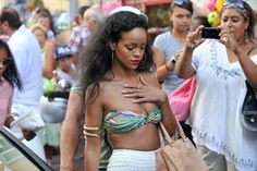 #Rihanna wears a bikini top while enjoying the sites in St. Tropez, France.