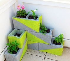 Love the idea for using cement blocks as a corner planter... or maybe to border a garden:) I would do solid colors