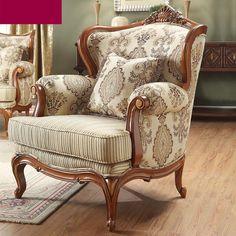 Кресло с бежевой обивкой и темно-коричневыми рисунками на ножках из дерева в интерьере гостиной купить в интернет-магазине https://lafred.ru/catalog/catalog/detail/16801801576/