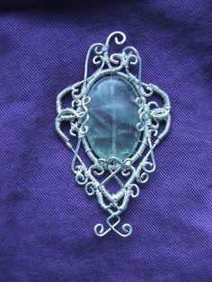 Elf pendant( wire,fluorite)