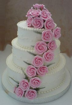 Rose Cascade - Aptly named, this cake features a trail of beautiful sugar roses cascading from top to bottom.  http://www.divineweddingcakes.co.uk/rose_cascade.shtm#