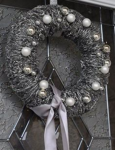 This wreath tutorial was meant to be a Christmas wreath tutorial but I think that it could also be used for Halloween. The metallic pot scrubber is an interesting idea!
