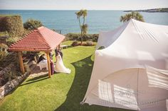 Open air ceremony in clifftop garden at Grand Hotel Wedding Photographs. Photography by one thousand words wedding photographers
