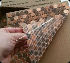 The mesh backing of each penny tile sheet follows the outline of every penny.