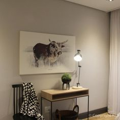 Painting of a Nguni with a dressing table and contemporary chair in Bedroom Refreshed Designs