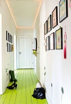 lime green floorboards...gotta love the bright colour and plain white walls!