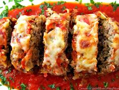 Italian Meatloaf | 1 yellow onion, diced     1 fire roasted red pepper, diced     olive oil, for sauteing         5 cloves garlic     1 vine-ripened tomato, diced         1 tablespoon dried Italian seasoning     1 egg     3/4 cup tomato sauce     1 teaspoon Worcestershire sauce     1 + 1/4 pounds ground beef or turkey     1/2 cup Italian seasoned bread crumbs         1/4 teaspoon black pepper     2 tablespoons Parmesan cheese, grated     1 + 1/2 cups mozzarella cheese, shredded