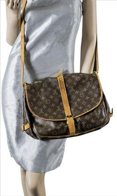 """Product: Saumur 35 Brown Cross Body Bag  Type: Cross Body Bags Louis Vuitton Style Name: Saumur 35 Measurements: 13.4""""L x 11""""H x 9.3""""W Color: Brown Brand: Louis Vuitton Fabric: Monogram Style/Collection: Louis Vuitton Saumur 35 Style Tags: Louis Vuitton Cross Body Bags Price: $358.50   For more collections of our stylist bags please visit https://www.tradesy.com/closet/envylv"""
