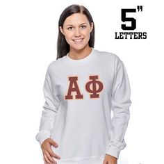 This multi-color printed lettered Greek Crewneck Sweatshirt is friendly both on your skin and on your wallet. Sweatshirt only comes in White and features your Sororities' Greek Symbols on the front. Y