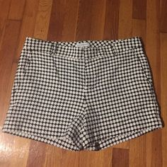 """White and Black Woven Polka Dotted Shorts Black shorts with white polka dots. Made out of a woven material. Two pockets in front and two in back. Cotton and acrylic material. 4 and 1/2"""" inseam. Worn once. Like new condition. Banana Republic Shorts"""