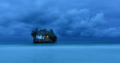 "Photo contest - Dale Johnson / National Geographic Traveler Photo Contest: ""The Rock restaurant just offshore in Zanzibar. As the sun set, I was taking photos of The Rock before going out there to have dinner. As the light levels dropped, the light came on in the restaurant and I knew I had my shot."" Dale Johnson."