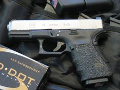Custom Glock G19 (9mm). Lone Wolf Distributors slide - frame customization by Robar - GL101O sights by Trijicon - Storm Lake match barrel - Grip Force grip adaptor (to eliminate slide bite), Vickers Tactical slide stop lever