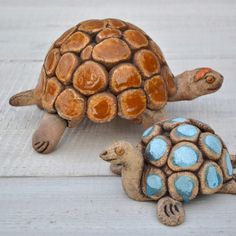 Turtle in darker clay body with stain and glaze accents.