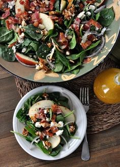 This really is the best spinach salad ever! Loaded with sweet + spicy nuts, apples, feta, and bacon, it is amazingly delicious. #spinachsalad #feta #bacon #amazingsalad #sidedish #melskitchencafe