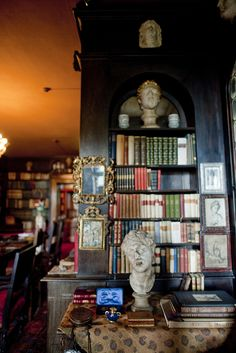 "European warmth - Books on shelves & tables in Gabriele d'Annunzio's ""Globe Room"" in his home ""Vittoriale"" in Lombardy, Italy."