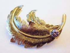 1990's Gold Plated Feather Brooch with Light Amethyst Swarovski Crystal Chaton by RetroroxJewellery on Etsy