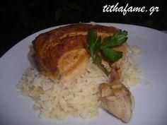 Μπούτια κοτόπουλου με ρύζι στο φούρνο
