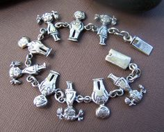 Another great estate find! Sterling silver links of adorable children linked hand to hand create this one of a kind bracelet. Closes securely