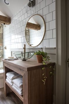 We don't use vessel sinks a lot, but I loved the idea of using one in this space with this custom vanity. It has plenty of towel storage, but doesn't take up a lot of unnecessary bathroom square footage.