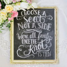 """This elegant, yet rustic print is the perfect way to welcome guests to your ceremony and set the tone for your special day. """"Choose a seat not a side - We're all family once the knot is tied"""" is hand lettering on a chalkboard and then digitally converted for printing."""