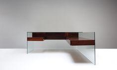 ANTOINE PHILIPPON/JACQUELINE LECOQ 3  /  5 Glass desk, 1967 Rosewood, glass and aluminum 190 x 188 x 75 cm
