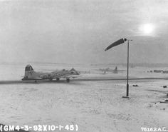 B-17G Fortress with the 327th Bomb Squadron taxis for take-off at snow covered Podington Airfield, Bedfordshire, England for a morning mission to Gymnich Airfield; Jan 10 1945. (US National Archives)