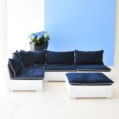 Avalon Collection Navy -- all-weather rattan modular lounge units in white with navy upholstery and white piping