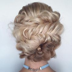 Messy fishtail braid updo.