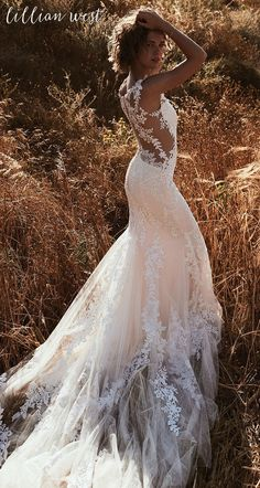 Gorgeous wedding dress. Very unique as well. Style 6485: Hand-Placed Lace Fit and Flare with Illusion Side Cut Outs #lillianwest #wedding #weddingdress #bridal #bridalgown #bohobride #bohowedding #outdoorwedding