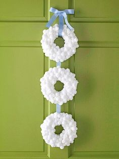 "Cute Christmas ""Snowball"" Mini-Wreaths made by gluing on fluffy white pompoms and hanging with ribbon"