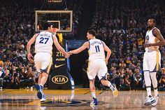 Klay Thompson and Zaza Pachulia of the Golden State Warriors high five each other during the game against the Dallas Mavericks on December 30 2016 at...