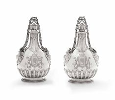 A PAIR OF VICTORIAN SILVER PILGRIM-FLASKS   MARK OF GEORGE FOX, LONDON, 1867, RETAILED BY LAMBERT, LONDON   mid 19th Century, All other categories of objects   Christie's Charles Fox, King George I, Water Flask, Christian Ix, Royal Families Of Europe, Female Mask, The Royal Collection, London Museums, Plate Display