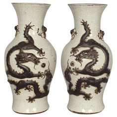 1stdibs | Pair of Chinese Ceramic Vases with Dragon Ornaments.