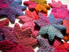 Knitted stars, to be joined into a garland. Super-pretty.