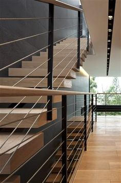 :: STAIRS :: beautifully executed stair detail by Pitsou Kedem architect, simple and well done. Centre steel stringer with solid wood treads. Wood handrail detail with steel vertical supports. #stairs #wood