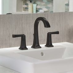 Photo Image The Townsend high arc widespread bathroom sink faucet from American Standard features an ADA pliant set of metal lever handles for handicap accessible