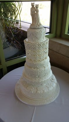 This Wedding Cake is one of my most favorite cakes with the exception of doing Christy's for Black Mountain Golf Club I enjoyed doing the edible jewelry for her cake.